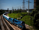 The first train using new equipment from China rides past, in Havana, Cuba, Saturday, July 13, 2019. The first train using new equipment from China pulled out of Havana Saturday, hauling passengers on the start of a 915-kilometer (516-mile) journey to the eastern end of the island as the government tries to overhaul the country's aging and decrepit rail system. (AP Photo/Ramon Espinosa)