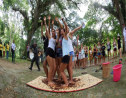 "The Women Football Team from Chico State University in California USA experiencing ""dancing the cocoa"" during a Lopinot Heritage Cocoa Tour. (Trinidad Tourism Ltd)"