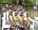 Students from Prospect Primary School in St. Thomas relax in their Peace Garden.