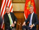 In this photo taken October 4, 2019, United States Secretary of State Mike Pompeo, left, speaks with Montenegro President Milo Djukanovic, in Podgorica, Montenegro. (AP Photo/Risto Bozovic)