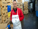 In this photo taken October 28, 2019, fishmonger Kristjan Asgeirsson is seen at work in Reykjavik, Iceland. Asgeirsson lost $68,000 in an online scam. (AP Photo/Egill Bjarnason)