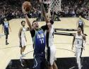 Dallas Mavericks guard Luka Doncic (77) drives to the basket against San Antonio Spurs center Trey Lyles (41) during the second half of an NBA basketball game in San Antonio, Wednesday, Feb. 26, 2020. (AP Photo/Eric Gay).