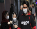 Pedestrians wear masks to help guard against the Coronavirus, in downtown Tehran, Iran, Sunday, February 23, 2020.  (AP Photo/Ebrahim Noroozi)