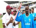 West Indies fast bowler Kemar Roach (right) leads his team off the field following a victory over England.