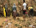 A group of people search through debris for a missing girl after a landslide in Shooters Hill, St Andrew on Friday.