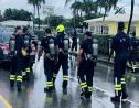 Not even the rain could stop these Cayman Island Fire Service Blue Watch members walking for charity.