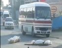 A screengrab from a video in which two bodies are seen on an Arima Street after they fell out of a funeral home's transport vehicle.