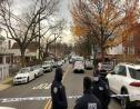 New York Police officers block off the street near the scene where a suspect was killed during a shootout with US marshals in the Bronx that left two officers wounded, Friday, December 4, 2020, in New York. (AP Photo/Mark Lennihan)